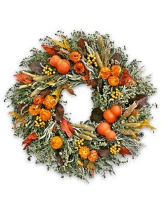 Our Fall Harvest Dried Wreath is a glorious assemblage of herbs, florals, berries, and gourds.