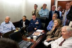 President Barack Obama and Vice President Joe Biden, along with with members of the national security team, receive an update on the mission against Osama bin Laden in the Situation Room of the White