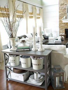 Label metal buckets using a stencil for instant charm and helpful organization. These buckets were painted cream first to go with this living room's color palette.