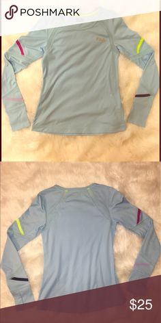 FILA Long Sleeve Workout Top This workout top is the cutest baby blue color! There are mesh details on the sleeve to help keep you cool. Never worn and in perfect condition! Fila Tops Tees - Long Sleeve