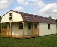 Derksen Portable Painted Lofted Barn Cabin with wrap around porch. Visit www.derksenbuildingstx.com