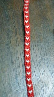 Kumihimo hearts. Looks like it uses 11 strands. On round Kumihimo loom. Pattern given