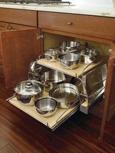 Organization at its finest, the Base Pots and Pans Pullout features independent pullouts as well as side rails to fit taller bakeware or other flat items, utilizing every possible inch of space. Pan Organization, Kitchen Cabinet Organization, Kitchen Storage, Kitchen Cabinets, Kitchen Appliances, Organizing, Updated Kitchen, New Kitchen, Kitchen Decor