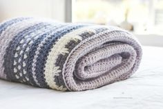 Envelope yourself in the warmth and serenity of the Winter Tempest Blanket, as it gently transports you to a quaint little cottage by the seaside.