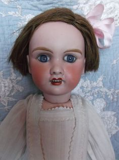 Lovely antique bisque French doll PETITE FRANCAISE, paperweight eyes