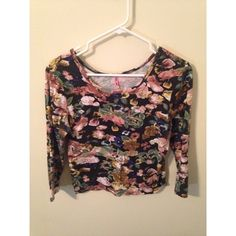 Floral Crop Top Floral crop top with 3/4 length sleeves. Semi longer than normal crop top. Very stretchy. Distressed look. Worn once. Rue 21 Tops Crop Tops