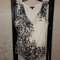 EXPRESS sheer tank top Express tank top....sheer front with design and plain white cotton back. Soft material.  Loose draped scoop neck.  Excellent condition. 100% polyester front. 60% cotton 40% modal back. Machine wash cold. Dry flat. Express Tops Tank Tops
