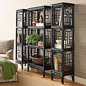 Chinese Chippendale Bookshelves. Intricatefretworkand a semigloss lacquered finish give this collection classic style. The bookcases, each with three fixed shelves, have open backs and lattice work sides. Handcrafted with solid poplar frames. $899