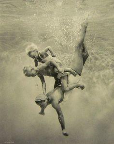vintage piggyback ride underwater