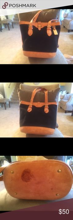 Dooney&Bourke vintage bag Dooney&Bourke vintage Black with tan leather handles. Slide buckle closure. Stain on bottom see pic. Gold hardware and feet. Very lovingly used. Dooney & Bourke Bags Totes