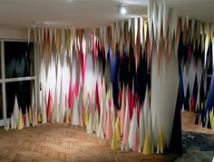 Hundreds of Paper Cones Create Colorful Cave Installation