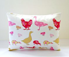 This listing is for the lovely 12 x 16 inch decorative lumbar pillow cover in photo 1 - it has ducks, chicks, chickens and geese in various shades of cerise and rose pink, dark yellow lime, with polka dots and roses on a soft white background. The 16 inch cover in photo 3 is also available here: www.etsy.com/uk/listing/188595587/decorative-pillow-cover-pink-ducks?ref=shop_home_active_1  The coordinating rose pink cover in photo 4 is available here: www.etsy.com/u...
