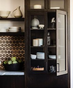 Kitchen Cabinetry Details by DISC Interiors. Blackened oak cabinetry with Soapstone counters and handmade tile from Cle Tile
