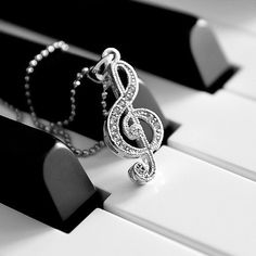 Find images and videos about music, necklace and piano on We Heart It - the app to get lost in what you love. Touches De Piano, Instruments, Music Jewelry, Music Necklace, Music Wallpaper, Treble Clef, Piano Music, Piano Keys, Music Lovers