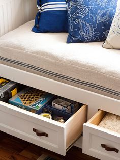 Playing Games-Playing Games Drawers pull out from under the daybed to reveal clever storage for games when the homeowner is entertaining. Store items near the place you are most likely to use them for an easy and convenient way to stay organized.