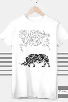 RHINO T shirt Ornamental Rhino Boho T shirt for Men and Women    Short Sleeve T-Shirt    • 100% ringspun cotton  • Pre-washed  • Double-stitched neckline  • Classic Fit  • Fabric weight 3.7 oz  • Print Ink is Water based and Eco-friendly. This makes the feel much softer and durable.    These soft vintage feel t-shirts come pre-washed and pre-shrunk, making sure that your size and color will hold up with time…