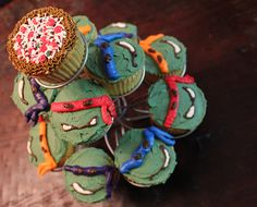 Teenage mutant ninja turtles cupcakes (and one pizza one)  These are soooo cute... I need place to make thses for me...