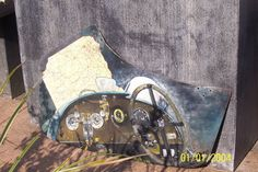 A Morgan threewheel dashboard, a working place for him ( Gary) and her ( Barbara) Caroline.  Painted on a rusty door from a Morgan +4 of 1960.