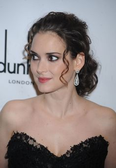 Winona Ryders wavy, ponytail hairstyle