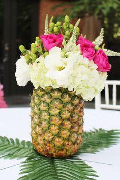 pineapple flower arrangements; Hawaiian party ideas; luau party ideas