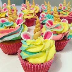 Unicorn vanilla cupcake with multi color buttercream.