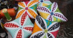 Cathedral Window Pincushion is fun and easy to make. You don't believe me? So choose your favorite fabric scraps and let's get sewing!   Ok...