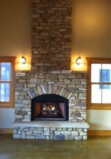 River Rock Fireplace But needs a big reclaimed wood mantle