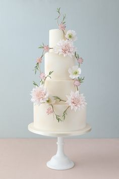 Simple and elegant wedding cake. The sugar wreath and flowers are gorgeous!