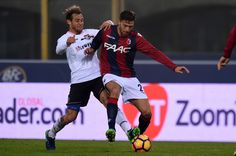 Luca Rizzo (R), of Bologna, is challenged by Alessandro Diamanti (L), of Palermo,  during the Serie A match between Bologna FC and US Citta di Palermo at Stadio Renato Dall'Ara on November 20, 2016 in Bologna, Italy.