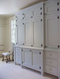Stunning Contemporary Kitchen Inspired By Colonial Era : White Cabinetry  Modern Williamsburg Kitchen With Small Upholstered Chair