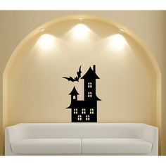 Give your home a spooky accent with this Halloween-themed wall decor. Made with glossy black, easy-to-apply vinyl, this fun wall decal features the image of a bat flying over an old-fashioned and eerie haunted home.