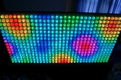 It's a 512 pixel array of fully addressable RGB LEDs diffused with one ping pong ball each.  How cool is this?