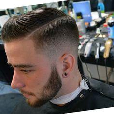 Low fade side part pomp for men