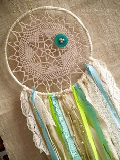 Romantic Boho Dream catcher with Vintage Lace Ivory Circle  Hand made from natural products. This is one of a kind decor. Perfect for wedding, home decor. Boho chic and perfect for the free spirited. These are one-of-a-kind vintage doily dreamcatchers.  Size: Ring: 7,6 ( 19.5 cm ) Overall length: 18.8 ( 48 cm)  Please note: Dream catcher is delicate in nature - do not use it outdoors in rainy weather.  This made in my smoke free studio.  Ready for shipping Dreamcatchers are carefully…
