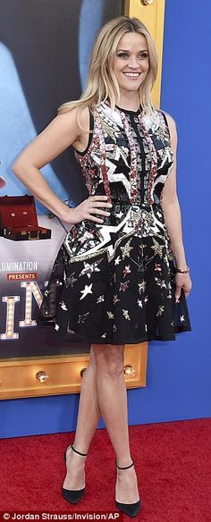 Nashville born: Reese - born Laura Jeanne - looked patriotic in a sequinned star-spangled sleeveless dress and black stilettos selected by her stylist Leslie Fremar