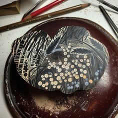 Work in progress from Angie Lewin as she starts a new wintry wood engraving making use of an odd shaped block.