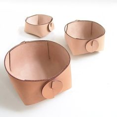 Set of three leather storage baskets - organizer boxes in minimalist nordic design with circle motif