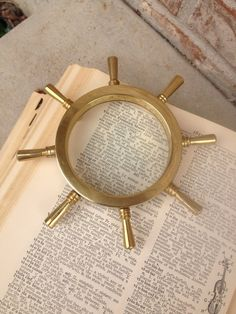 Mid Century - Incredible Brass Ship Wheel Magnifying Glass / Paperweight / Office Decoration / Display on Etsy, $16.95