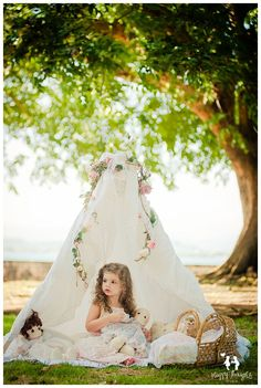 Girl playing with dolls in outdoors tent Children Photography