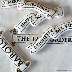 Embroidered-letter ornaments - from Japanese embroidery designer at yumikohiguchi.blog105.fc2.com   #badges