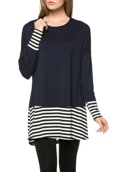 95%Rayon 5%Spandex MADE IN USA This cool and comfortable top features a scoop neckline, long dolman style sleeves, relaxed fit, and striped hemline panel. Our L