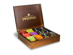 Twinings deluxe wooden compartment box filled with 144 mixed individually wrapped tea bags.