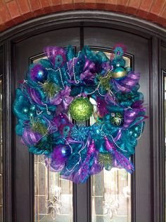 Handmade peacock wreath think I mmight need to add this to my mardi gras décor at Christmas