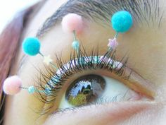 Eyelash jewelry with tiny pompoms. Available in Rainbow and Cotton Candy colors. Flexible, easily curved to fit your eyelid. Attach with regular