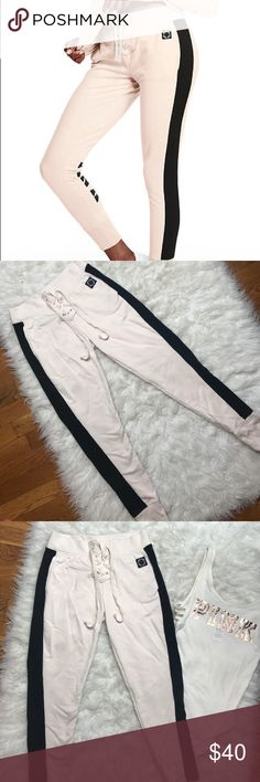 VS PINK Skinny Lace Up Pant XS VS PINK skinny collegiate lace up pant in a natural off white, vanilla color. Only worn twice. No trades! Size XS! PINK Victoria's Secret Pants Track Pants & Joggers