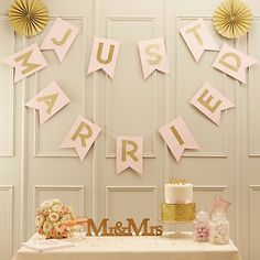 This eye catching bunting adds a touch of glitz to any wedding ceremony.  Each golden letter shimmers on its own flag.  The bunting is held by twine and measures 3.5m in length.