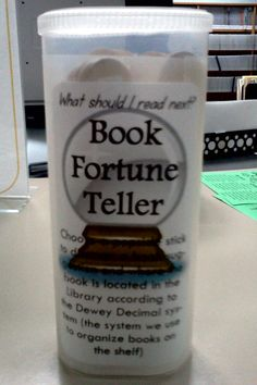 """Book Fortune Teller (Crystal Light container plus popsicle sticks) Kids pull a stick which tells them a call number range and the subject, like """"a book about dogs."""" They learn basic Dewey and enamored with the """"fortune telling"""" aspect"""