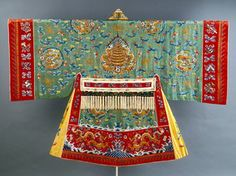 A Chinese Daoist (Taoist) silk and metal priest's coat, c.1870, embroidered with auspicious symbols from Buddhist and Daoist iconography, including a pagoda (symbol of paradise), dragons and pearls of wisdom, the attributes of the eight Daoist immortals, the eight auspicious Buddhist symbols, the sun and moon. (Indianapolis Museum of Art)