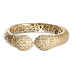 Rivka Friedman Hinged Cuff Bracelet features ornated end caps of pave' Cubic Zirconia. Cuff Bracelet has a hammered texture with a satin finish. Hinged closure allows for easy wear. Imported. Comes wi...