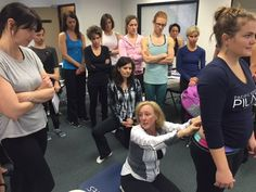 Melanie Byford-Young illustrating with the assistance of PT and therapeutic Pilates pro Cassie Diamond.  #LumbarSpine #SIJoint #PacificNWPilates #EducationWorkshop #TherapeuticPilates #PortlandOR #March2016